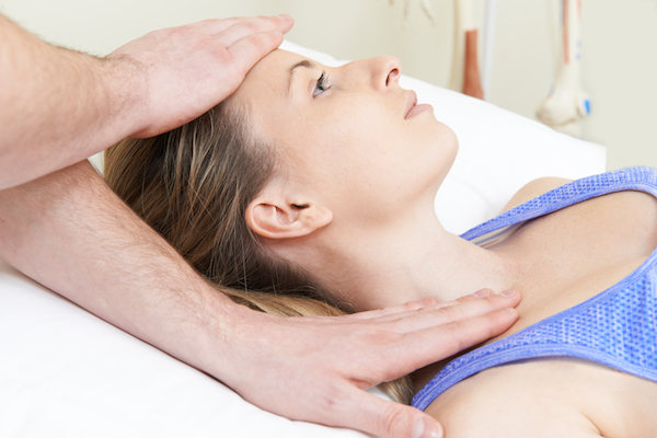 woman receiving osteopathic treatment on neck